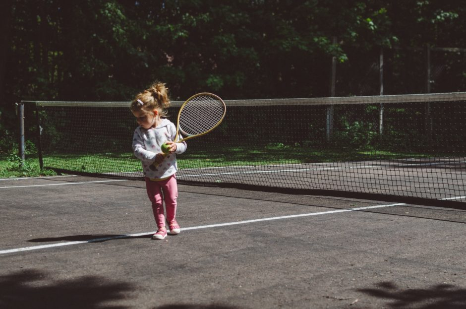 a little girl on the court